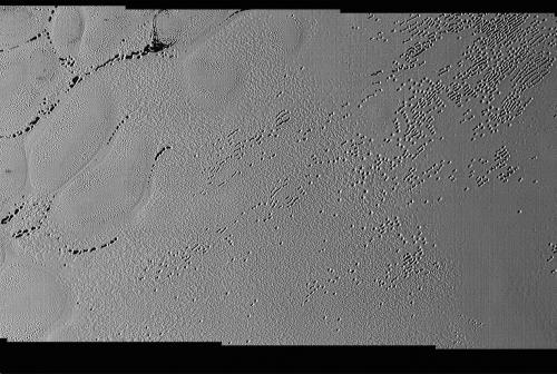 new-horizons-data-reveal-puzzling-patterns-and-pits-on-pluto